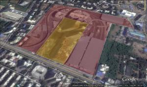 The purple bigger portion is 30 acres and the carved out light yellow portion is 8 acres.